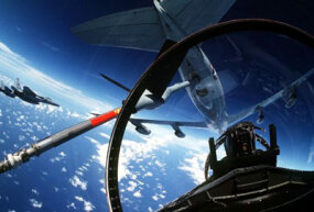 的 F-15 bubble canopy gives the crew a wide view of the sky. This plane is preparing to refuel.