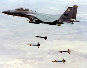 An F-15 Strike Eagle drops Mark 84 laser-guided bombs during a training exercise.