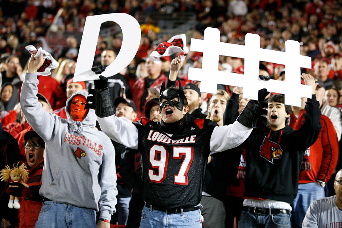 Cardinals fans cheer for the defense during a game against the Florida State Seminoles at Papa John's Cardinal Stadium on Oct. 30, 2014 in Louisville, Kentucky.  Joe Robbins/Getty Images