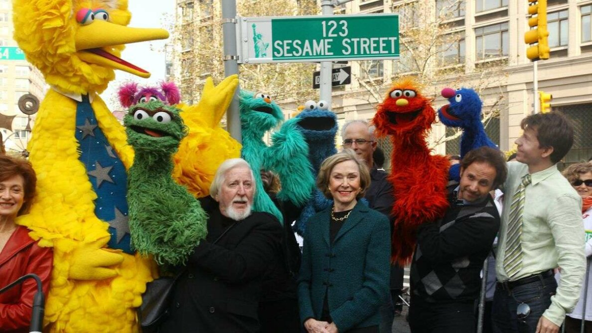 Puppeteer Caroll Spinney (who animates Big Bird and Oscar), Sesame Street co-founder and TV producer Joan Ganz Cooney, and Sesame Street cast members pose under a '123 Sesame Street' sign at the 'Sesame Street' 40th Anniversary temporary street renaming. Astrid Stawiarz/Getty Images