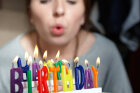 Why do people think it's bad luck not to blow out all the birthday candles in one breath?