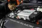 How do hybrid car designs aid in fuel efficiency?