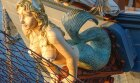 Why are mermaids on ships' prows considered good luck?