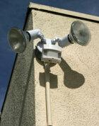 How do motion sensing lights and burglar alarms work?