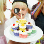 Decorate cupcakes with plastic swords or gold coins.