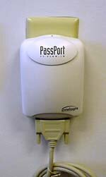 To install an Intelogis PassPort power-line network, you plug a wall device like this into an outlet.
