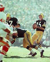 The first Super Bowl: Quarterback Bart Starr of the Green Bay Packers drops back to pass. The Packers beat Kansas City 35 to 10.