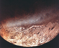 When Voyager 2 passed Neptune, one of the last things it photographed was the moon Triton. Scientists were amazed to see that this distant moon had a very unusual surface. The dark smudges on the lighter part of the moon are nitrogen geysers.
