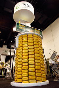 Kernels of corn are used to cover a fuel pump on display to promote ethanol fuel at the Pioneer display at the International Fuel Ethanol Workshop & Expo in the Colorado Convention Center in Denver, on June 17, 2009.