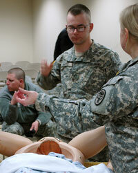 An Army OB/GYN instructs medics on delivering babies and emergencies that may arise during pregnancy.