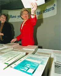 Internal Revenue Commissioner Margaret Milner Richardson hands out tax forms in Washington, D.C., in April 1995. The IRS really does want you to file -- something.­­