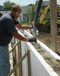 With this type of construction, workers pour concrete into forms that act as insulation.