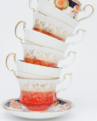 A leaning tower of teacups used as a centerpiece is a fun element at a spring garden wedding.
