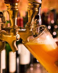 A bottle will do, but beer on tap is the ultimate home bar beverage.