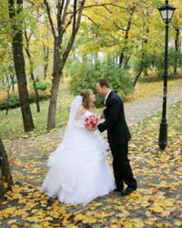 Autumn leaves provide a beautiful backdrop for your wedding portraits.