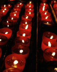 Votives with a flickering amber flame provide instant ambience for your Halloween wedding