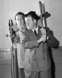 """American comedy duo Bud Abbott and Lou Costello performing their famous """"Who's On First"""" routine for a 1947 NBC radio broadcast."""