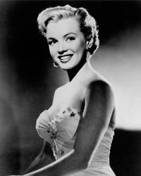 Marilyn Monroe often wore dresses and blouses with a sweetheart neckline, which is flattering to both a little cleavage or a lot.