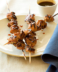 Brush chicken skewers with marinade before tossing them on the grill. You'll get a succulent, savory final product.