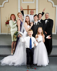 Your wedding party photo can be formal, but it doesn't have to be. Choose what suits your family best.
