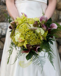 This showstopping bouquet is filled with organic greens and deep, dramatic lavenders.