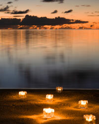 Get innovative with votives! At outdoor receptions, add illumination where you want guests to wander and mingle.