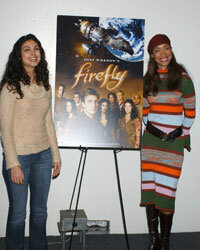 "Series actresses Morena Baccarin and Gina Torres pose with a ""Firefly"" poster at the 2003 Los Angeles Comic Book and Science Fiction Convention."