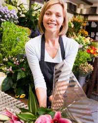 A wedding planner with connections to a florist might be able to get you some freebies.