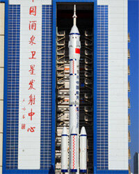 A Long March 2F rocket carries the Shenzhou-8 spacecraft at the Jiuquan Satellite Launch Center on Oct. 26, 2011. Shenzhou-8 successfully docked with the unmanned space module Tiangong-1 in November 2011.
