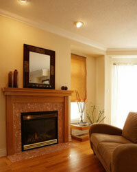 A fireplace with a few simple decorations makes a nice focal point, while a mirror can make any room seem larger.