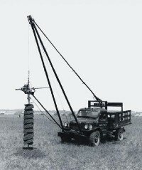 This posthole digger, steadied by the cable from the optional winch on the front of a 1948 Dodge Power Wagon, could do its work in just a few minutes.