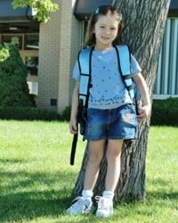 Taking pictures of your kids on their first day of school each year will create a collection of photos that you'll treasure long after they've grown up.