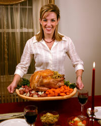If that smile looks a little forced, it could be because of how much time and money it takes to put together a memorable holiday meal. See more pictures of Thanksgiving turkey.