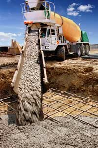 A fully-loaded concrete truck may weigh 30 tons (27,215 kilograms).