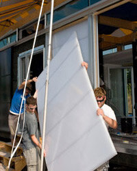"""Georgia Tech students install """"light walls"""" on their energy-efficient home displayed at the National Mall's 2007 """"Solar Village."""""""
