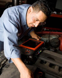 Using a diagnostic computer, a mechanic can view a car's digitally stored information and determine exactly what the problem is.