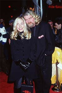 Joe Eszterhas and his wife attend the premiere of 'An Alan Smithee Film: Burn Hollywood Burn' in 1998 in Westwood, Calif. Eszterhas was the screenwriter of this box office bomb.