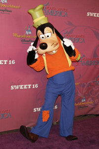 The whole standing-on-two-legs thing makes Goofy an anthropomorphized dog. The pants and suspenders don't help either.