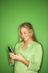 Cell phone users can hold instant messaging chats by using AOL.