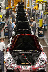 Employees of car manufacturer Porsche assemble the Porsche 911 on a production line in Stuttgart, Germany, in 2008.
