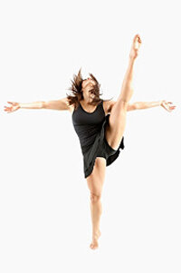 A dancer performs a battement in second position.