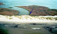 Changes in Louisiana's Isle Dernieres barrier island before (top images) and after (bottom images) Hurricane Andrew in 1992. The arrows indicate identical, corresponding points on the top and bottom images.