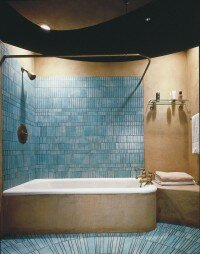 Aqua tiles on walls and floor provide a focal point.