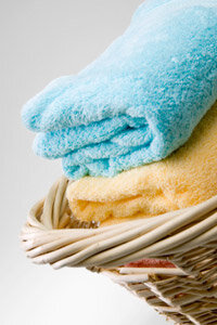 No place for those fresh towels? Try a decorative wicker basket.