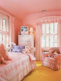 Carol R. Knott Interior Design                              Cheerful, but not overly girlish,                                            this bedroom decor will stand                                            the test of time.