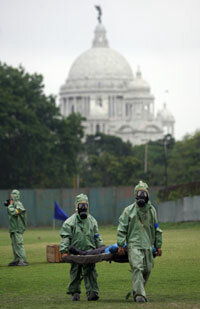 Indian soldiers shift an injured man to an emergency treatment center during a mock exercise in the event of a Chemical and Biological terror attack, in Kolkata on April 17, 2008.