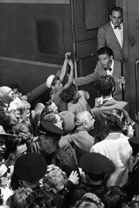 Fans mob heartthrob crooner Frank Sinatra.