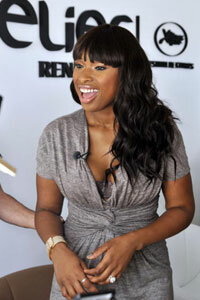 Jennifer Hudson looks sleek and curvy in a solid grey dress cinched at the waist.
