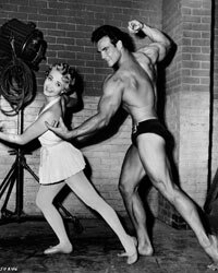"Jane Powell as Athena Mulvain dances with Steve Reeves as Ed Perkins in the film ""Athena"" in 1954."