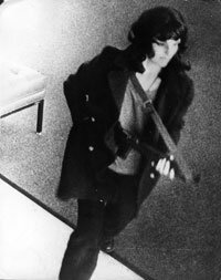 Patty Hearst is caught on surveillance camera during a bank robbery in San Francisco.